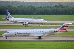 "American CRJ 700 ""N526EA"" x United 737-900ER ""N27421"" (Dulles_Aviation) Tags: n526ea american airlines crj crj700 iad kiad dulles airport united boeing 737900er n27421 737 airbus"