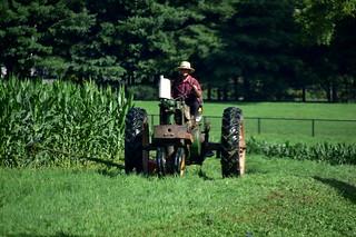 amish man on tractor