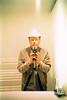 reflected self-portrait with Kodak SIX-20 C camera and triangular hat (pho-Tony) Tags: cameraselfportraits xpro fujiprovia kodaksix20browniec kodak six20 brownie c box boxcamera boxbrownie 620 roll flm rollfilm 6x9 6cmx9cm mediumformat simple cheap 1950s fuji provia 100 fujiprovia100 e6 transparency crossprocess crossprocessing tetenal c41 expired