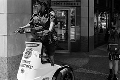 be careful. (mojave1951) Tags: nikomatel nikkorsauto50mm14lens ilfordhp5film seattle streetphotography streetportrait blackandwhite blackandwhitefilm seatle