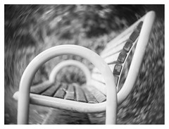 Rocking bench (leo.roos) Tags: bench bank rockingbench schommelbank noiretblanc swirly hugomeyerkinonsuperiorif5cm meyerkinonsuperiori5016 projectorlens projectionlens focusinghelicoidtrioplan10028 exakta adaptedtom42 darosa leoroos
