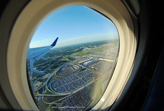 Departing ATL (Infinity & Beyond Photography) Tags: atlanta airport departure aerial view window seat 8mm fisheye samyang lens avaiation photos photography landscape wing winglet terminal parking lot garage