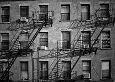 Then the sunlight dims (Mister Blur) Tags: new york city building stairs shadows dusk sunlight nyc bricks windows air conditioned blackandwhite bw blancoynegro snapseed thenational demons rubén rodrigo fotografía nikon 35mm d7100
