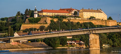 2018 - Serbia - Danube - Petrovaradin Fortress (Ted's photos - For Me & You) Tags: 2018 cropped nikon nikond750 nikonfx novisad serbia tedmcgrath tedsphotos vignetting petrovaradinfortress petrovaradinfortressnovisad petrovaradinfortressserbia fortress bridge novisadserbia petrovaradinfortressclocktower clocktower clock river danuberiver danube umbrellas bluesky blue