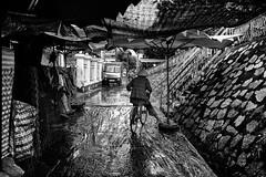 In the mud (rvjak) Tags: caibe vietnam d750 nikon black white noir blanc bw street rue bicycle bicylette vélo hat chapeau woman femme boue