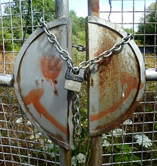 A Lock. (jenichesney57) Tags: lock circle metal face paint fence squares trees panason5clumix chain link