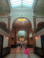 Arch and Pediment at East End of West Great Hall (Autistic Reality) Tags: westgreathall west greathall great hall donaldwreynoldscenterforamericanartandportraiture americanart americanportraiture portraiture art si smithsonian architecture smithsonianinstitution donaldwreynolds center donaldwreynoldscenter institution museum structure building washington dc district columbia districtofcolumbia capital portraits gallery patentofficebuilding patentoffice robertmills thomasuwalter oldpatentofficebuilding greek revival greekrevival adolfcluss nationalportraitgallery portraitgallery saam americanartmuseum smithsonianamericanartmuseum npg normanfoster hartmancoxarchitects grunleywalshconstructionco usa unitedstates unitedstatesofamerica us america interior inside indoors southhall south wing southwing modelhall model