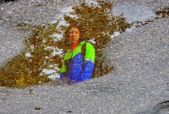 Water Art: Amazing what one sees in a wet road (+1) (peggyhr) Tags: peggyhr waterart asphalt road reflection flipped woman lakelouise alberta canada rainpuddle thelooklevel1red thelooklevel2yellow thegalaxy thegalaxystars visionaryartsgallerylevel1 infinitexposurel1 thegalaxylevel2 infinitexposurel2 thegalaxystarshof
