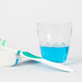 Toothbrush, toothpaste and mouthwash on white background