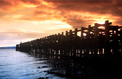 Sunset over the old pier (moffatt) Tags: sunset colour reflection water silhouette evening riverclyde clyde pier warm filter filters helensburgh moffatt craigendoran interestingness304 i500 buautiful