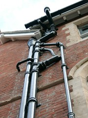 Plumbe Rohrschau II. (Animaux) Tags: red sky black brick window wall gothic pipes plumbing oxford rohre