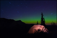 Midnight Rendezvous (_Jezza_) Tags: park nightphotography camping trees canada mountains nature silhouette canon stars outdoors star nightlights outdoor trails canadian tent adventure alberta wilderness northernlights abigfave ilovebnature canadacanadacanada