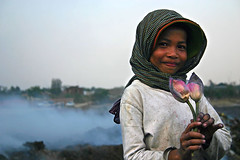 Flowers in the dump - Phnom Penh, Cambodia (Maciej Dakowicz) Tags: poverty people flower 2004 girl children garbage asia cambodia dump environment mean phnom landfill penh chey stung meanchey earthasia
