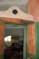Bluegreen doors with curvaceous arch and stained glass (jungle mama) Tags: newmexico tile fireplace doors arch stainedglass handpainted taos stainedglasswindow stucco johndavid taosnewmexico domehouse taosnm bedroombalcony adobehome domehousewithkoipond livinginadome domedesigner adobedome bedroomdoors handpaintedadobe domehousekitchen fireplaceindomehouse