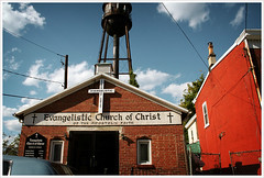 Evangelistic Church of Christ of the Apostolic Faith (Mr. Biggs) Tags: old city red church buildings newjersey religion watertower driveby churchofchrist biggs trenton mrbiggs