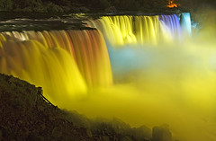 Niagara Falls (Wolfgang Staudt) Tags: travel blue panorama usa newyork ontario water colors beautiful yellow fog wow wonderful river lights niagarafalls boat nikon holidays rocks waves darkness nikond70 availablelight sigma falls waterfalls horseshoe wilderness lovelovelove vacancy wolfgang americanfalls spotlights peopleschoice niagarariver travelphotographie thegalaxy sixsixsixclub wolfgangstaudt staudt sigmaaf356328300dgmacro superaplus aplusphoto irresistiblebeauty favemegroup6 superhearts themawasserfoto colourartaward artlegacy alemdagqualityonlyclub nikonflickraward grouptripod creativecollection bealivebetopbeseven