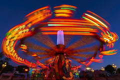 the Wizard... (Blende1.8) Tags: funfair kirmes karussell fahrgeschäft crange crangerkirmes ruhrgebiet ruhrpott nrw herne light licht bluehour blauestunde speed movement bewegung bewegungsunschärfe langzeitbelichtung longexposure lightbeam lightbeams orange wizard farben colors colours colourfull colorful vividcolours sony alpha ilce7m3 1224mm sel1224g a7m3 a7iii wideangle carstenheyer