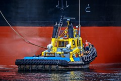 When push comes to shove (Christie : Colour & Light Collection) Tags: tugboat tug ship vancouver pushing push shove tugs workboat boats water ocen bc canada outdoors menatwork maneuver assist placement nikon dslr tires ladder man person ropes