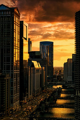 Chicagolden Hour (Carl's Captures) Tags: sunset goldenhour cityscape chicagoillinois cityofchicago architecture theloop thechicagoriver wackerdrive windows traffic streetlights reflections framing vertical bridges streets downtown urban buildings highrises clouds backlight landscape evening atmosphere lunareclipse aerial vista orange gold bling dusk summer nikond7500 sigma18300 photoshopbyfehlfarben thanksbinexo