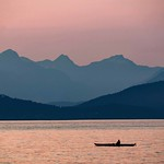 Lone kayaker in setting sun over English Bay Vancouver thumbnail
