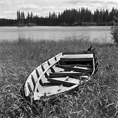 old boat, Procter Lake in the Flathead valley, B.C. (andy curtis) Tags: film 120mm 120 6x6 ilfordfp4 fp4 yashicamat vintagecamera twinlensreflex tlr rodinal boat blackandwhite bw monochrome mediumformat