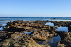 Rockery @ Beaumaris (Marian Pollock) Tags: australia melbourne beaumaris beach shoreline shallows sailboats reflections victoria sky sunny daytime rockery autumn coast sunlight water