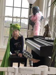 Madeleine plays on the piano in a pig costume today (dionhinchcliffe) Tags: moblog iphonepics