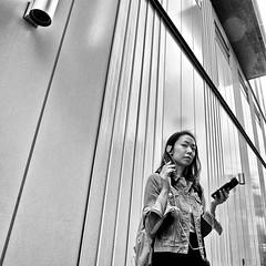ebisu, japan (michaelalvis) Tags: asia bw blackandwhite buildings candid city cellphones citylife cellphone fujifilm ebisu japan japanese japon monochrome nihon nippon peoplestreet portrait peoplestreets travel tokyo urban w woman x70
