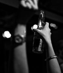 Showtime Drinks (Santa Cruz Pictographer) Tags: black white grey gray bw light dark show arm audience crowd bar stage watch arms blurry bokeh performance music