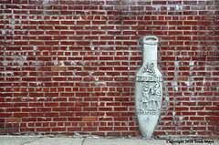 Just Another Amphora In The Wall (Trish Mayo) Tags: amphore sculpture art brickwall astoria queens