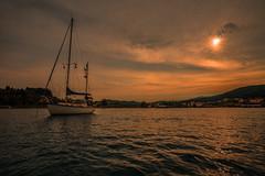 The sunset hour..... (Dafydd Penguin) Tags: sun set sunset anchor anchorage mooring bay sea water evening light yacht yachting boat sail sailboat petriti corfu greece sailing coastal coast cruising leica m10 elmarit 21mm f28