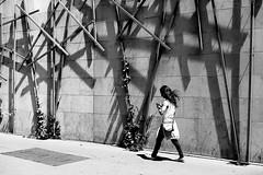 Under bars (pascalcolin1) Tags: paris13 femme woman barres bars mur wall plantes plants photoderue streetview urbanarte noiretblanc blackandwhite photopascalcolin 50mm canon50mm canon