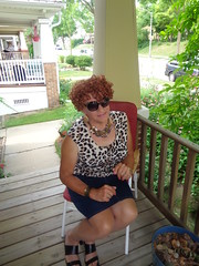 Ready To Spring Into Action! (Laurette Victoria) Tags: porch denim skirt sunglasses animalprint redhead curly woman laurette