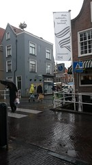 20180809_162253 (Nomen Nescio14) Tags: delft rainyday rain raincoat yellowraincoat yellow buildings people