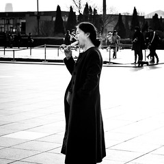 Refresh (Go-tea 郭天) Tags: dongbei liaoning dalian xinghai square ice cream cold warm hot sunny sun shadow old woman lady portrait eat eating enjoy enjoying alone lonely canon eos 100d 50mm prime street urban city outside outdoor people candid bw bnw black white blackwhite blackandwhite monochrome naturallight natural light asia asian china chinese food