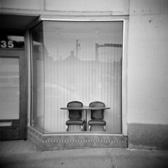 Port Angeles #1 (LowerDarnley) Tags: holga portangeles wa washington northwest storefront closed chairs blinds table