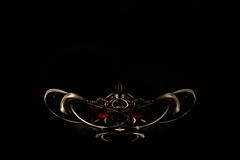 @MacroMondays #trinkets (Mari Van Cauteren) Tags: lowkey macromondays trinkets bracelet gold red black macro abstract