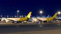 Yellow Twins! (Jaws300) Tags: runway taxiway apron ramp eiheb eihea irish ireland yellow tail vhhh hkg hkia clk hong kong air dhl ahk cargo freight freighter converted a330300f a330300 a330f a333f a333 a330 airways airlines asl hongkongcheklapkokinternationalairport cheklapkok cheklapkokairport lantauisland canon5d parked parking stand remotestand cargoapron airhongkong dragonair cathay dragon night