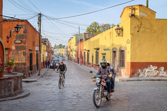 two wheelers (bugeyed_G) Tags: sanmigueldeallende mexico colonial historic unesco transportation tourism travel hispanic street worldheritagesite bicycle motorbike