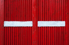 Ribbed Red Metal Texture With White Surface (dejankrsmanovic) Tags: ribbed white rib metal texture red background color simple abstract detail pattern material old retro vintage obsolete painted paint cover door fence gate garage structure line weathered aged closeup stilllife object board