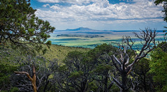 A volcano with a view (Paul Domsten) Tags: volcano newmexico pentax grasslands capulinvolcano clouds trees