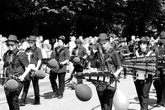 Parade (Von Noorden) Tags: noiretblanc einfarbig wand black white blackandwhite bw sw schwarzweiss germany schwarz weiss weis schwarzweis shade monochrome plain woman cheers baroque costume old flowers carnival hat blackwhite glass glas festival procession parade traditional personen person marching band musican musiker cornet xylophon trumpet drum corps fanfare ballons sunglass sunglasses porkpie