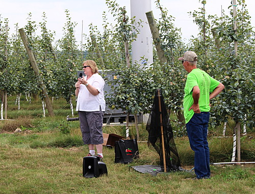Amy Irish-Brown discussing ways to trap brown marmorated stink bugs with Phil Schwallier listening.