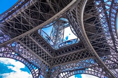 A look up through the bottom of the Eiffel tower.