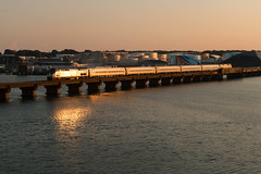 Golden Glint (jc_canon) Tags: amtrak amtrakdowneaster downeaster foreriver portlandmaine amtrak688 688 goldenhour bridge railroadbridge train passenger passengertrain