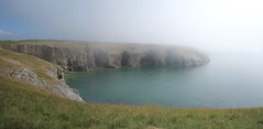 atmospheric coast (squeezemonkey) Tags: pembrokeshire wales countryside broadhaven sea seafog mist landscape cliff cove water calmsea coast rock caves