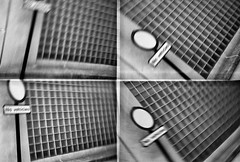 Surrey Place (Delay Tactics) Tags: sheffield film road street sign no vehicles grid window four 4 actionsampler black white bw circle blur intentional camera movement icm