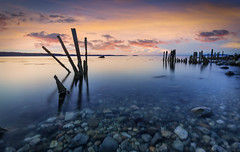 Afterglow (Ffotograffiaeth Dylan Arnold Photography) Tags: groynes longexposure afterglow clouds orange blue seascape landscape foreground wood sticks outdoors calm tranquil abstract jagged warm cool coast coastline beach lavansands northwales snowdonianationalpark rocks pebbles transparent water smooth travel puffinisland greatorme wideangle shadows nature peaceful still wales snowdonia
