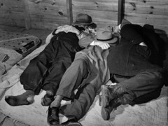 Impoverished farmers sleeping in a white camp room in a warehouse. They often must remain several days before their tobacco is sold. Durham, North Carolina, 1939. (polkbritton) Tags: greatdepression marionpostwolcott 1930s vintagefashion northcarolinahistory fsaowi libraryofcongresscollections