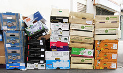 Boxes from the produce shop, stacked for the Sunday garbage pickup (Monceau) Tags: boxes produce empty stacked trash garbage